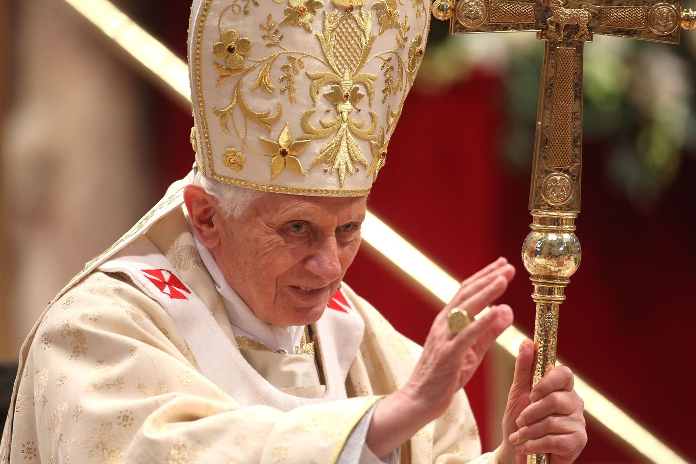 VATICAN CITY, VATICAN - FEBRUARY 19:  Pope Benedict XVI waves as he leaves St. Peter's Basilica at the end of a mass with  newly appointed cardinals on February 19, 2012 in Vatican City, Vatican. The 84 year old Pontiff installed 22 new cardinals during his fourth concistory, who will be responsible for choosing his sucessor.  (Photo by Franco Origlia/Getty Images)