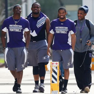 Northwestern University football players make their way to the building where voting is taking place to determine if student athletes want to join a union in Evanston, Illinois