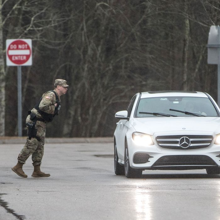 A member of the military police speaks to an out-of-state driver on Sunday at a checkpoint in Richmond, Rhode Island that was set up in the first rest stop on I-95 after the Connectictut-Rhode Island border.