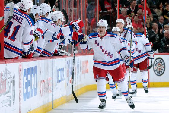 OTTAWA, CANADA - APRIL 23:  Chris Kreider #20 of the New York Rangers celebrates his second period goal with teammates in Game Six of the Eastern Conference Quarterfinals against the Ottawa Senators during the 2012 NHL Stanley Cup Playoffs at the Scotiabank Place on April 23, 2012 in Ottawa, Ontario, Canada.  The Rangers defeated the Senators 3-2.  (Photo by Richard Wolowicz/Getty Images)