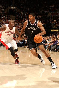Joe Johnson #7 of the Brooklyn Nets drives to the basket against Mickael Pietrus #20 of the Toronto Raptors on December 12, 2012 at the Air Canada Centre in Toronto, Ontario, Canada.