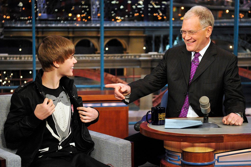 Justin Bieber, left, shows Dave his tuxedo shirt on the Late Show with David Letterman, Monday Jan. 31, 2011 on the CBS Television Network.Photo: John Paul Filo/CBS?2011 CBS Broadcasting Inc. All Rights Reserved