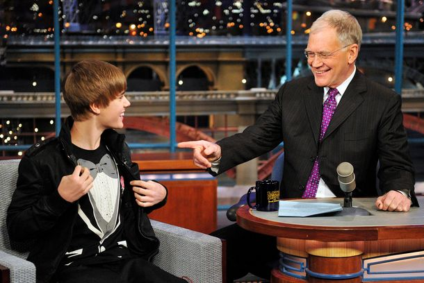 Justin Bieber, left, shows Dave his tuxedo shirt on the Late Show with David Letterman, Monday Jan. 31, 2011 on the CBS Television Network.Photo: John Paul Filo/CBS©2011 CBS Broadcasting Inc. All Rights Reserved