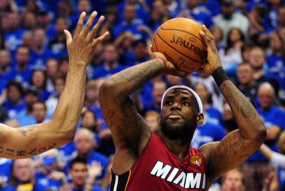 LeBron James (R) of the Miami Heat shoots against the Dallas Mavericks during Game 3 of the NBA Finals at the AmericanAirlines Center in Dallas on June 5, 2011. The Heat defeated the Mavericks 88-86.      AFP PHOTO/Mark RALSTON (Photo credit should read MARK RALSTON/AFP/Getty Images)