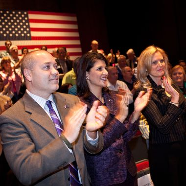 CHARLESTON, SC - DECEMBER 17:  South Carolina Gov. Nikki Haley (C) with Ann Romney, wife of Republican presidential candidate former Massachusetts Gov. Mitt Romney and Michael Haley applaud after a town hall meeting at the Memminger Auditorium on December 17, 2011 in Charleston, South Carolina. Romney is attempting to boost the momentum of his campaign following the conservative endorsement of South Carolina Gov. Nikki Haley.  (Photo by Richard Ellis/Getty Images)