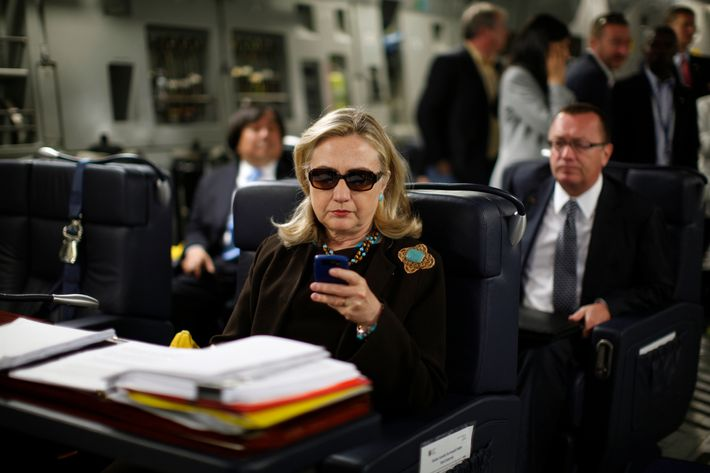U.S. Secretary of State Hillary Clinton checks her PDA upon departure in a military C-17 plane from Malta bound for Tripoli, on October 18, 2011.