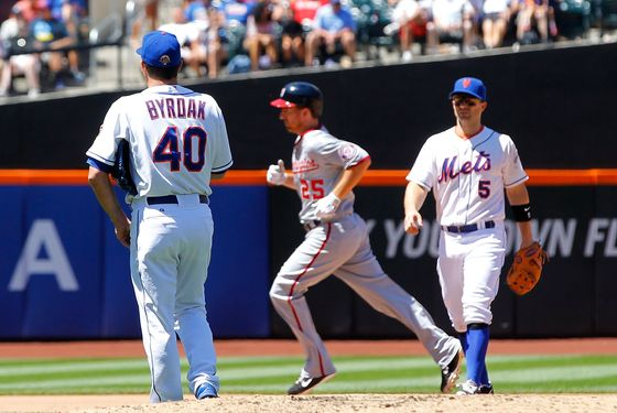 NEW YORK, NY - JULY 25: Tim Byrdak #40 and David Wright #5 of the New York Mets looks on as Adam LaRoche #25 of the Washington Nationals runs the bases after his seventh inning two run home run at Citi Field on July 25, 2012 in the Flushing neighborhood of the Queens borough of New York City. (Photo by Jim McIsaac/Getty Images)