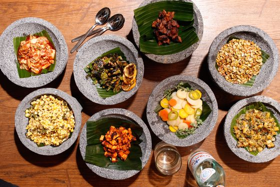 Toppings include corn and poblano salad; grilled scallion with lemon; pickled jalapeño and carrot; charred pineapple salsa; Napa-cabbage kimchi; crispy quinoa; Fritos; toasted pumpkin seeds.