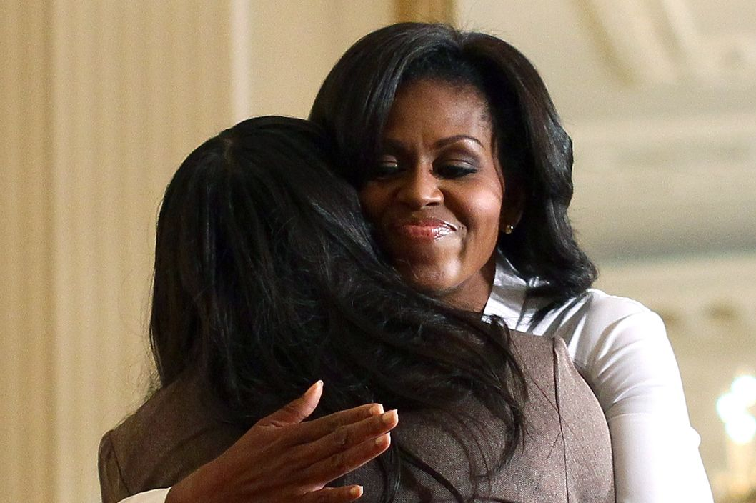 U.S. first lady Michele Obama hugs college student Michelle Del Rio of El Paso, Texas at a White House event on the importance of supporting and retaining women and girls in science, technology, engineering and math careers September 26, 2011 in Washington, DC. At the East Room event, the National Science Foundation also made an announcement about retaining women in science, technology, engineering and math fields.
