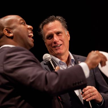 Republican presidential candidate former Massachusetts Gov. Mitt Romney listens to a question from U.S. Rep. Tim Scott (R-SC) during a town hall meeting at the Memminger Auditorium on December 17, 2011 in Charleston, South Carolina. Romney is attempting to boost the momentum of his campaign following the conservative endorsement of South Carolina Gov. Nikki Haley.
