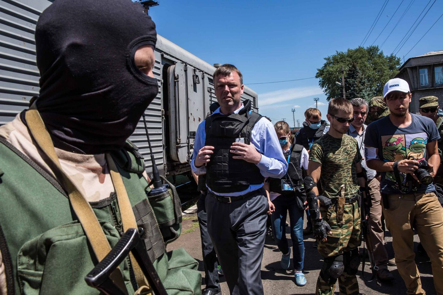 Alexander Hug (C), Deputy Chief Monitor of the Organisation for Security and Cooperation in Europe (OSCE) Special Monitoring Mission to Ukraine, visits a train containing the bodies of victims of the Malaysia Airlines flight MH17 crash on July 21, 2014 in Torez, Ukraine. Together with Dutch inspectors, the storage conditions were declared acceptable, though it is still unclear where or when the train will be moved. Malaysia Airlines flight MH17 was travelling from Amsterdam to Kuala Lumpur when it crashed killing all 298 on board including 80 children.