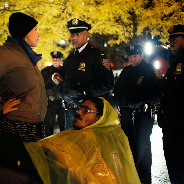 NEW YORK, NY - NOVEMBER 16: An Occupy Wall Street protester confronts the NYPD when they enforce a no sleeping rule in Zuccotti Park on November 16, 2011 in New York City. Police had removed the protesters from the park early in the morning. A judge ruled that protesters are allowed back to the park but won't be allowed to camp there. Hundreds of protesters, who rallied against inequality in America, have slept in tents and under tarps since September 17 in Zuccotti Park, which has since become the epicenter of the global Occupy movement. The raid in New York City follows recent similar moves in Oakland, California, and Portland, Oregon (Photo by Allison Joyce/Getty Images)