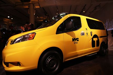 People look at the new New York City taxi which is designed by the Nissan Motor Co. at an official unveiling on April 3, 2012 in New York City. The new taxis, which will start appearing on the streets of New York next year, service an estimated service 600,000 people daily. The 2014 NV200 Taxi will replace the fleet of iconic Ford Crown Victorias, Ford Escape Hybrids and Toyota Siennas that are currently being used. Some of the highlights of the new taxi include front and rear-seat occupant curtain airbags, a window on the roof, backseat cellphone charging and USB ports and passenger reading lights.NEW YORK, NY - APRIL 03:  People look at the new New York City taxi which is designed by the Nissan Motor Co. at an official unveiling on April 3, 2012 in New York City. The new taxis, which will start appearing on the streets of New York next year, service an estimated service 600,000 people daily. The 2014 NV200 Taxi will replace the fleet of iconic Ford Crown Victorias, Ford Escape Hybrids and Toyota Siennas that are currently being used. Some of the highlights of the new taxi include front and rear-seat occupant curtain airbags, a window on the roof, backseat cellphone charging and USB ports and passenger reading lights.  (Photo by Spencer Platt/Getty Images)