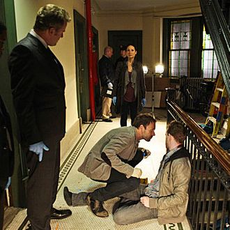 """???€?œWhile you Were Sleeping???€? ???€?"""" Sherlock (Jonny Lee Miller, center) uses his powers of deduction to consult on the murder of a young man who is shot upon entering his apartment. Also pictured is Jon Michael Hill (far right) Aidan Quinn (right), Lucy Liu (center) in ELEMENTARY on October 4 (10:00-11:00 PM, ET/PT) on the CBS Television Network. PHOTO CREDIT: GIOVANNI RUFINO/CBS ?'?? 2012 CBS. All Rights Reserved."""