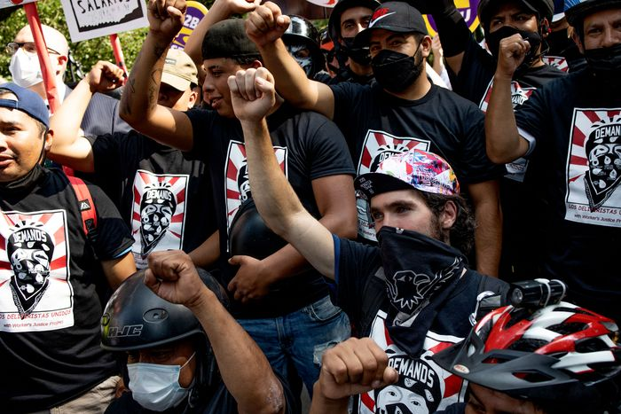 Members of the grassroots organization Los Deliveristas Unidos