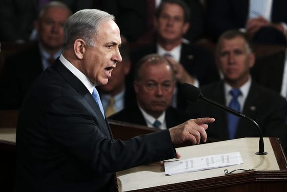 "Israeli Prime Minister Benjamin Netanyahu addresses a joint meeting of the United States Congress in the House chamber at the U.S. Capitol March 3, 2015 in Washington, DC. During his speech, Netanyah said, ""Today the Jewish people face yet another attempt by another Persian potentate to destroy us."" (Photo by Win McNamee/Getty Images)"