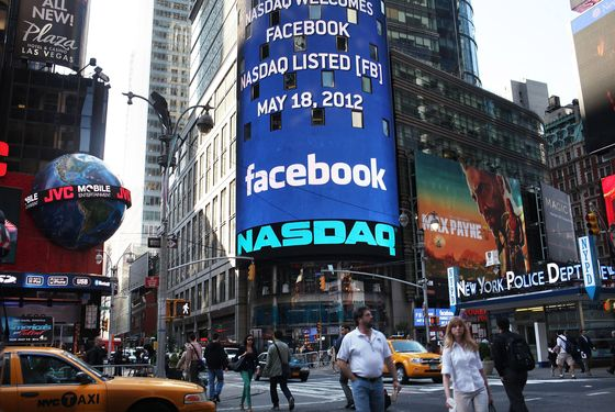 NEW YORK, NY - MAY 18: The Nasdaq board in Times Square advertises Facebook which is set to debut on the Nasdaq Stock Market today on May 18, 2012 in New York, United States. The social network site is set to begin trading at roughly 11:00 a.m. ET and on Thursday priced 421 million shares at $38 each. Facebook, a Menlo Park, California based company, will have a valuation exceeding $100 billion. (Photo by Spencer Platt/Getty Images)