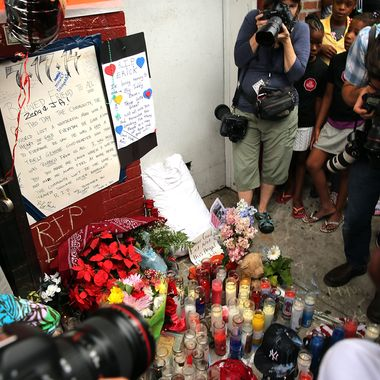 NEW YORK, NY - JULY 19:  A memorial to Eric Garner is viewed following a demonstration against his death after he was taken into police custody in Staten Island on Thursday on July 19, 2014 in New York City. New York Mayor Bill de Blasio announced in a news conference yesterday that there will be a full investigation into the circumstances surrounding the death of Garner. The 400-pound, 6-foot-4 asthmatic, Garner (43) died after police put him in a chokehold outside of a convenience store for illegally selling cigarettes.  (Photo by Spencer Platt/Getty Images)