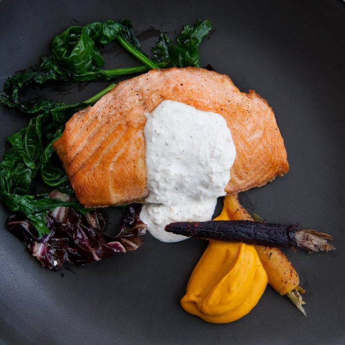 Faroe Island salmon with sautéed greens, cumin-roasted carrot puree, and horseradish crème fraiche.