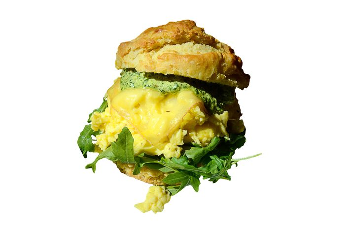 Egg-and-cheese biscuit with Spring Brook Farm's Ashbrook cheese, spicy greens, and aioli.