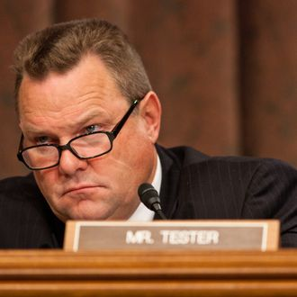U.S. Sen. Jon Tester (D-MT) listens during a hearing on Capitol Hill October 13, 2011 in Washington, DC. The Senate held a hearing to discuss the possibility of further economic sanctions on Iran in light of the recently revealed plot to assassinate a Saudi diplomat in Washington, DC.