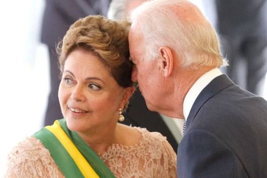 Brazil's President Dilma Rousseff, left, listens to U.S. Vice President Joe Biden, during President Rousseff's inauguration, at the Planalto Presidential Palace in Brasilia, Brazil, Thursday, Jan. 1, 2015. (AP Photo/Eraldo Peres)