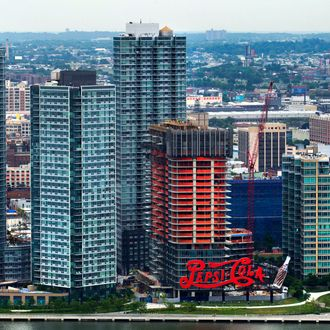The Long Island City waterfront and the Pepsi-Cola sign are seen from the 34th floor at 50 UN Plaza in New York, U.S., on Thursday, July 11, 2013. Located across the street from the United Nations, 50 UN Plaza, Arthur and William Lie Zeckendorf's latest Manhattan luxury-condominium project is a 44-story tower that will be the Turtle Bay neighborhood's first new residential project in a dozen years.