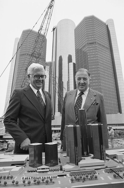 "1973-1977, Detroit, Michigan, USA --- Original caption: Saluting the start of construction on Phase II of Renaissance Center, Alton G. Marshall, (L) President of Rockefeller Center, Inc., and Henry Ford II, Chairman of the Board of Ford Motor Company, look over a model of the two new towers (left, foreground) as the Renaissance Center towers over the men. Ford said, ""The Rockefeller show of confidence in the future of Detroit was one of a string of important announcements here during the past year."" Marshall said, ""I am tremendously pleased that Rockefeller Center, Inc., is able to participate in this major urban development."""