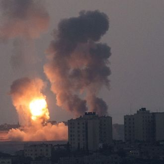 A picture taken from the southern Israeli border with the Gaza Strip shows smoke billowing during an Israeli air strike in the Palestinian coastal enclave, on July 8, 2014. Israeli warplanes killed at least 15 Palestinians in Gaza today, as well as another four militants who tried to infiltrate Israel by sea at the start of a major operation against rocketfire. AFP PHOTO / JACK GUEZ (Photo credit should read JACK GUEZ/AFP/Getty Images)