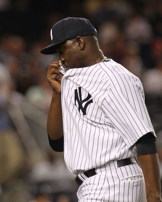 NEW YORK, NY - AUGUST 24: Rafael Soriano #29 of the New York Yankees walks to the dugout in the tenth inning after giving up a 3 RBI home run against the Oakland Athletics on August 24, 2011 at Yankee Stadium in the Bronx borough of New York City. (Photo by Nick Laham/Getty Images)