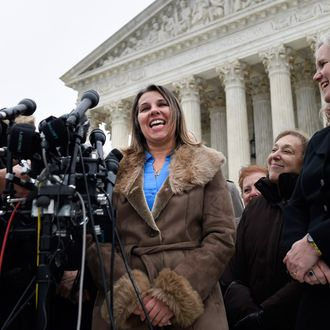 Peggy Young, a Virginia woman who lost her UPS job because she became pregnant, left, accompanied Marcia Greenberger, founder and Co-President of the National Women's Law Center, center, and Young's attorney, Sharon Fast Gustafson, right, speaks to reporters outside the Supreme Court in Washington, Wednesday, Dec. 3, 2014. The Supreme Court is weighing how much employers must do to accommodate pregnant workers under a federal law aimed at combating discrimination against them. (AP Photo/Susan Walsh)