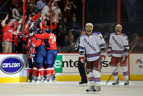 WASHINGTON, DC - MAY 09:  The Washington Capitals celebrate after Jason Chimera #25 scored a goal against the New York Rangers in Game Six of the Eastern Conference Semifinals during the 2012 NHL Stanley Cup Playoffs at Verizon Center on May 9, 2012 in Washington, DC.  (Photo by Patrick McDermott/Getty Images)