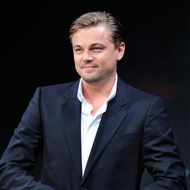 US movie actor Leonardo DiCaprio smiles as he adjust his jacket during a press conference to promote his latest film 'Inception' in Tokyo on July 21, 2010. The new movie will be shown all over Japan from July 23. AFP PHOTO/Toru YAMANAKA (Photo credit should read TORU YAMANAKA/AFP/Getty Images)