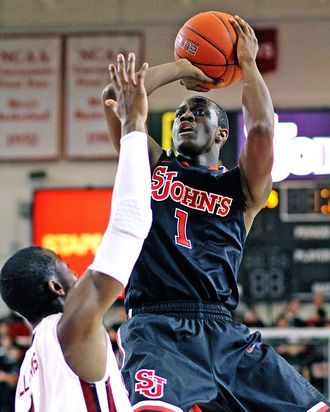 St. John's Phil Greene (1) shoots against South Carolina's Brenton Williams during their NCAA college basketball game, Thursday, Nov. 29, 2012, in New York. St. John's won 89-65.
