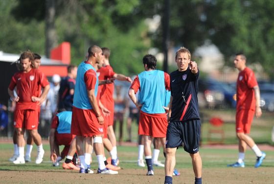 US national team coach Jurgen Klinsmann speaks to his players during a training session at the University of Maryland in College Park, outside Washington, on May 28, 2012 two days before an international friendly against Brazil.     AFP PHOTO/Nicholas KAMM        (Photo credit should read NICHOLAS KAMM/AFP/GettyImages)