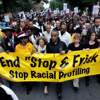 """Rev. Al Sharpton, center, walks with demonstrators during a silent march to end New York's """"stop-and-frisk"""" program. On Monday Aug 12, 2013, a U.S. District Court judge ruled that the New York Police Department deliberately violated the civil rights of tens of thousands of New Yorkers with its contentious stop-and-frisk policy, and said an independent monitor is needed to oversee major changes."""