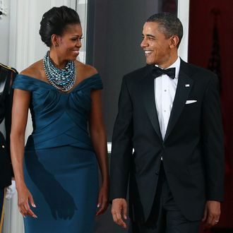 U.S. President Barack Obama and first lady Michelle Obama walk into the North Portico of the White House before attending a state dinner March 14, 2012.
