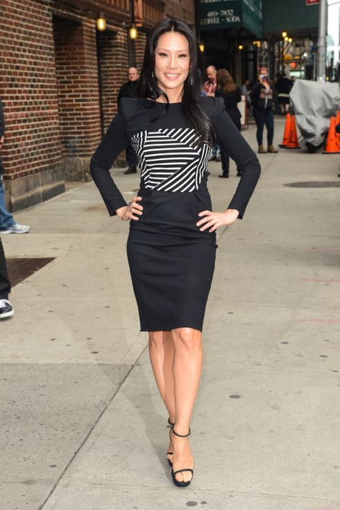 "Actress Lucy Liu enters the ""Late Show With David Letterman"" taping at the Ed Sullivan Theater on October 9, 2013 in New York City."