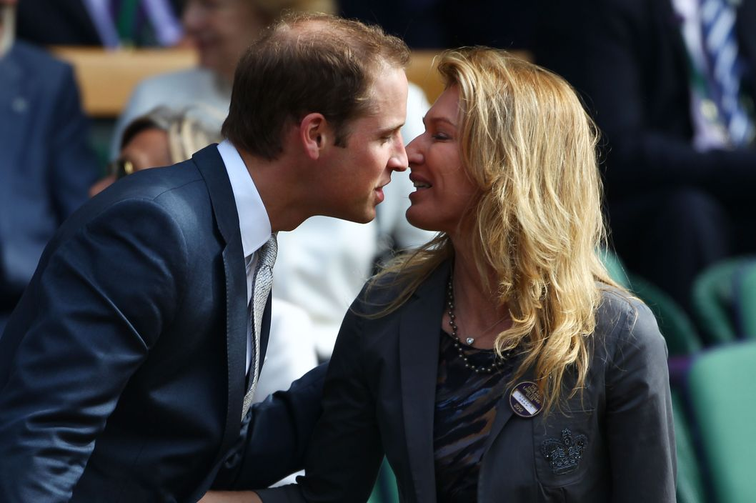 Stefanie Graf (R) greets Prince William, Duke of Cambridge in the Royal Box on Centre Court during day nine of the Wimbledon Lawn Tennis Championships at the All England Lawn Tennis and Croquet Club on July 4, 2012 in London, England.