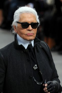 Fashion Designer Karl Lagerfeld appears at the end of the runway during the Chanel show as part of the Paris Fashion Week Womenswear Fall/Winter 2014-2015 on March 4, 2014 in Paris, France.