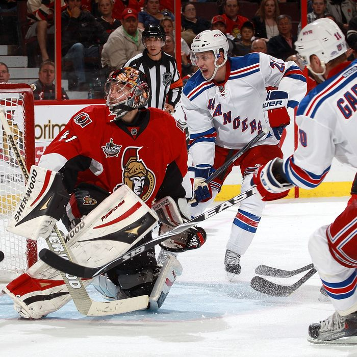 OTTAWA, CANADA - NOVEMBER 9: Marian Gaborik #10 of the New York Rangers scores a third period goal against Craig Anderson #41 of the Ottawa Senators as Derek Stepan #21 of the New York Rangers looks on during an NHL game at Scotiabank Place on November 9, 2011 in Ottawa, Ontario, Canada. (Photo by Jana Chytilova/Freestyle Photography/Getty Images)