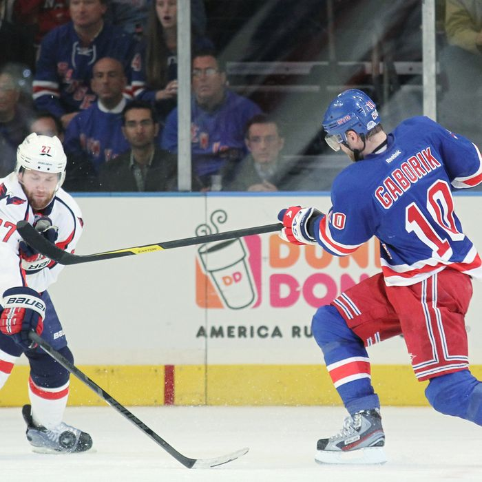 Marian Gaborik #10 of the New York Rangers controls the puck against Karl Alzner #27 of the Washington Capitals