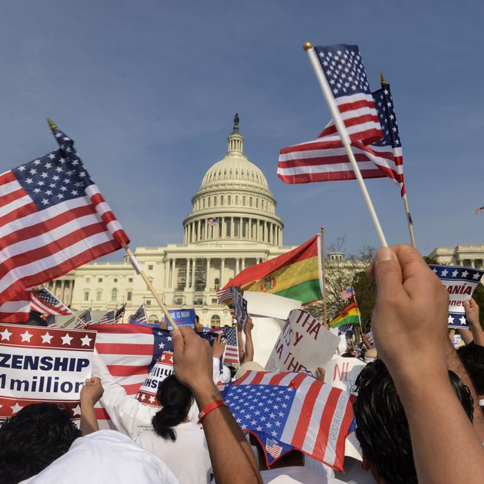 epa03657247 People show their support during a rally for comprehensive immigration reform on the West Front of the US Capitol in Washington DC, USA, 10 April 2013. Several thousand people attended the rally. EPA/MICHAEL REYNOLDS
