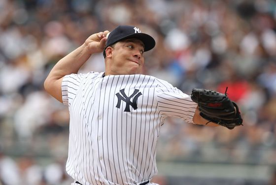 NEW YORK, NY - JULY 24:  Bartolo Colon #40 of the New York Yankees pitches against the Oakland Athletics during their game on July 24, 2011 at Yankee Stadium in the Bronx borough of New York City.  (Photo by Al Bello/Getty Images)
