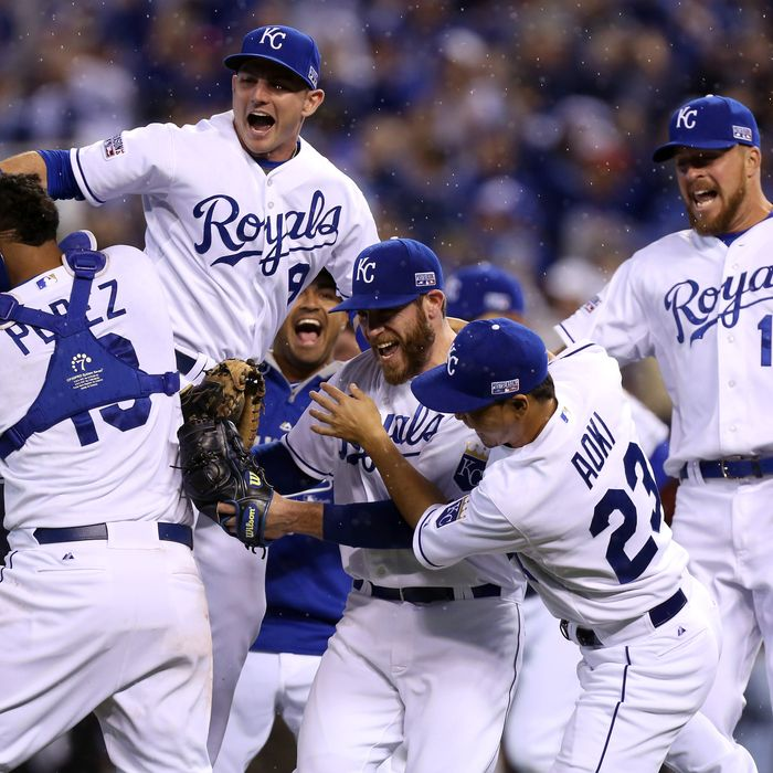 KANSAS CITY, MO - OCTOBER 05: Greg Holland #56 celebrates with Norichika Aoki #23 of the Kansas City Royals after defeating the Los Angeles Angels 8-3 in Game Three of the American League Division Series at Kauffman Stadium on October 5, 2014 in Kansas City, Missouri. (Photo by Ed Zurga/Getty Images)
