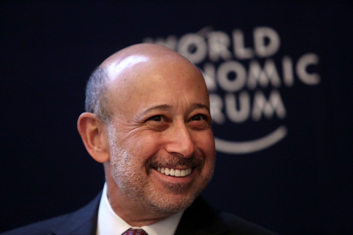 Lloyd Blankfein, chairman and chief executive officer of Goldman Sachs Group Inc., reacts during a session on day three of the World Economic Forum (WEF) in Davos, Switzerland, on Friday, Jan. 25, 2013. World leaders, influential executives, bankers and policy makers attend the 43rd annual meeting of the World Economic Forum in Davos, the five day event runs from Jan. 23-27.