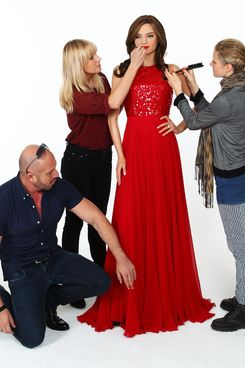 Alex Perry, a hairdresser and a make-up artist tend to a  Miranda Kerr wax figure as it is unveiled at The Photo Studio, Glebe on July 5, 2012 in Sydney, Australia.