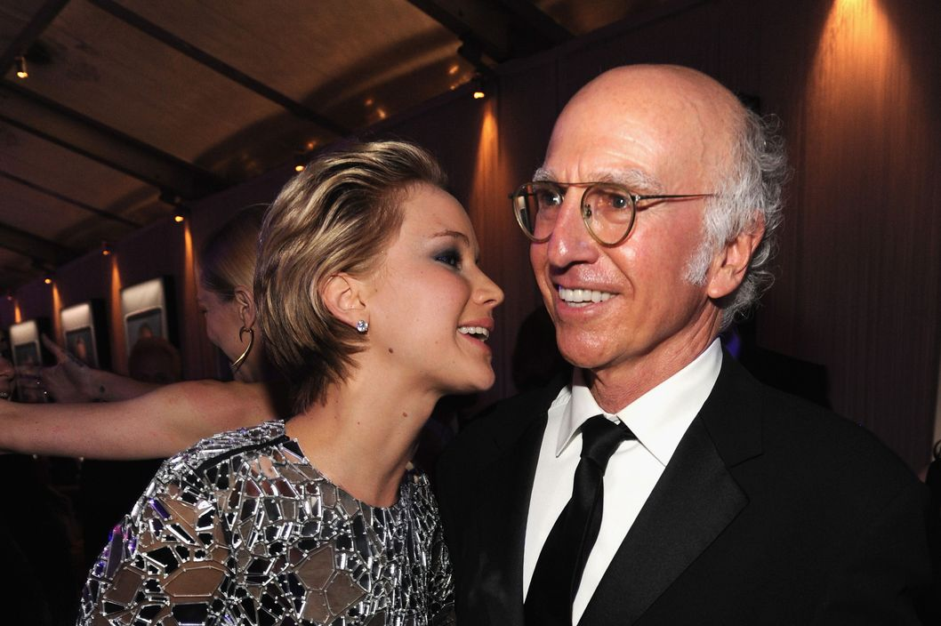 WEST HOLLYWOOD, CA - MARCH 02:  (EXCLUSIVE ACCESS, SPECIAL RATES APPLY) Jennifer Lawrence and Larry David attend the 2014 Vanity Fair Oscar Party Hosted By Graydon Carter on March 2, 2014 in West Hollywood, California.  (Photo by Kevin Mazur/VF14/WireImage)