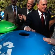 NEW YORK - OCTOBER 27:  New York Mayor Michael Bloomberg (2R), accompanied by New York Sanitation Commissioner John J. Doherty (2L), puts his hand on a new recycling bin at a press conference announcing the expansion of the city's recycling efforts October 27, 2008 in New York City.  New recycling bins are going to be placed in expanded locations in all five city boroughs.  (Photo by Chris Hondros/Getty Images) *** Local Caption *** John J. Doherty;Michael Bloomberg