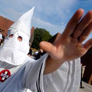 VALLEY FORGE, PA - SEPTEMBER 25: A member of the Ku Klux Klan salutes during American Nazi Party rally at Valley Forge National Park September 25, 2004 in Valley Forge, Pennsylvania. Hundreds of American Nazis from around the country were expected to attend.  (Photo by William Thomas Cain/Getty Images)